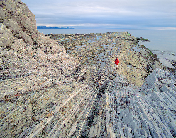 HIker at Green Point on sedimentary rocks at Gros Morne National Park, Newfoundland, Canada, AGPix_0233.