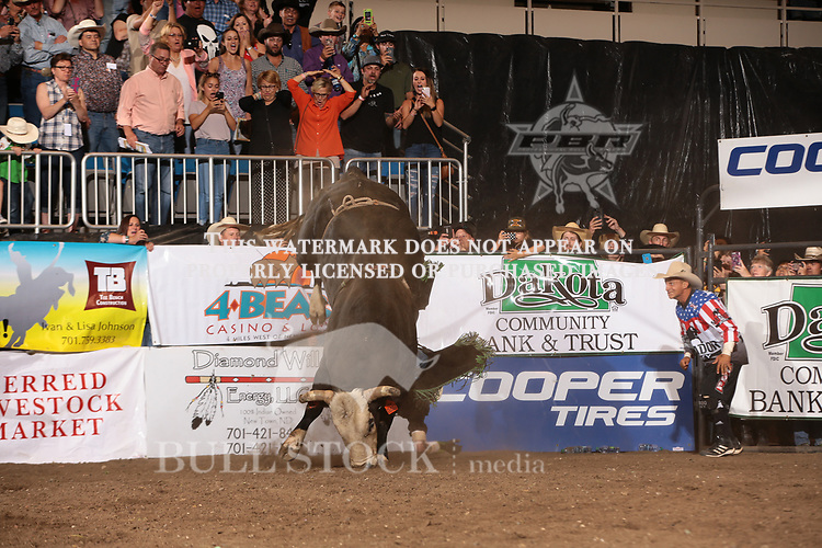 JB Mauney attempts to ride Dakota Rodeo/Chad Berger/Clay Struve/H&C Bucking Bulls's Pearl Harbor for $50,000 during the Championship round of the Bismarck Real Time Pain Relief Velocity tour PBR. Photo by Andy Watson