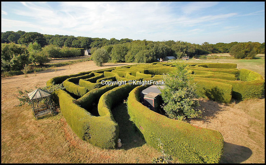 BNPS.co.uk (01202 558833)<br /> Pic: KnightFrank/BNPS<br /> <br /> Get lost... the eight foot high maze.<br /> <br /> The owners of this luxury property that has gone on the market can really tell nuisance callers to get lost - as it comes with its very own maze.<br /> <br /> Badsell Park Farm, near the village of Matfield, Kent, has 96 acres of land that includes the 8ft tall maze that covers an area of 12,000 sq ft.<br /> <br /> The 18th century property is valued at £2.6million.