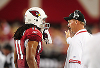 Aug. 22, 2009; Glendale, AZ, USA; Arizona Cardinals head coach Ken Whisenhunt (right) talks with wide receiver Larry Fitzgerald against the San Diego Chargers during a preseason game at University of Phoenix Stadium. Mandatory Credit: Mark J. Rebilas-