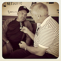 OAKLAND, CA - JULY 22: Instagram of New York Yankees former great player Reggie Jackson being interviewed by radio broadcaster Ray Fosse in the dugout before the game against the Oakland Athletics at O.co Coliseum on Sunday, July 22, 2012 in Oakland, California. Photo by Brad Mangin