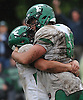 Christian Erkens #68, right, and Vincent Giachetti #74 of Farmingdale celebrate after their team's dramatic 45-42 win over host Massapequa High School in a Nassau County Conference I varsity football game on Saturday, Oct. 8, 2016.