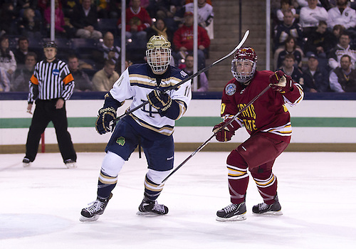 January 25, 2013:  Notre Dame left wing Jeff Costello (11) and Ferris State center Matthew Kirzinger (20) battle for position during NCAA Hockey game action between the Notre Dame Fighting Irish and the Ferris State Bulldogs at Compton Family Ice Arena in South Bend, Indiana.  Ferris State defeated Notre Dame 3-1.