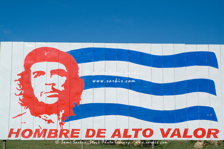 Billboard with the iconic Che Guevara portrait and national Cuban flag, Trinidad, Cuba.