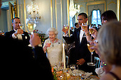 President Barack Obama offers a toast to Queen Elizabeth II during a dinner held in the Queen's honor at Winfield House in London, England, May 25, 2011. Actor Tom Hanks is pictured at left. .Mandatory Credit: Pete Souza - White House via CNP
