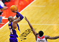 Kobe Bryant of the Lakers shoots over Jordan Crawford of the Wizards. Washington defeated Los Angeles 106-101 at the Verizon Center in Washington, D.C. on Wednesday, March 7, 2012. Alan P. Santos/DC Sports Box
