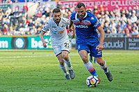 Erik Pieters of Stoke City (R) against chased by Angel Rangel of Swansea City during the Premier League match between Swansea City and Stoke City at The Liberty Stadium, Swansea, Wales, UK. Sunday 13 May 2018