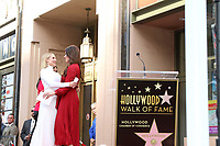 LOS ANGELES - OCT 19:  Kristen Bell, Idina Menzel at the Idina Menzel and Kristen Bell Star Ceremony on the Hollywood Walk of Fame on October 19, 2019 in Los Angeles, CA