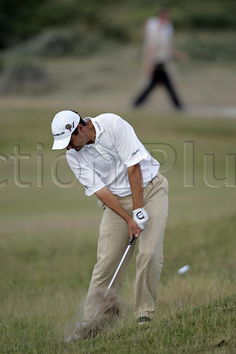16 July 2005: English golfer Simon Khan (ENG) plays from the rough on the 15th during his third round. Khan shot a 6 over par 78 to be 1 over par after 3 rounds at The Open Championship, The Old Course at St Andrews, Scotland. Photo: Glyn Kirk/Actionplus....050716 golf major british