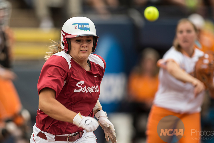 04 JUNE 2013:  Georgia Casey (42) of the University of Oklahoma tries to outrun a pass to first base against the University of Tennessee during the Division I Women's Softball Championship held at ASA Hall of Fame Stadium in Oklahoma City, OK. Oklahoma defeated Tennessee 4-0 to win the national championship.  Shane Bevel/NCAA Photos