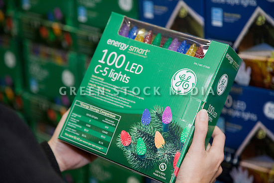 Close Up of woman holding sustainable holiday Lights in Store. General Electric brand 'Energy Smart' energy efficient LED holiday lights at Cosco. San Francisco, California, USA