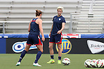 19 August 2014: Megan Rapinoe (right) with Meghan Klingenberg (left). The United States Women's National Team held a public training session at WakeMed Stadium in Cary, North Carolina.