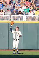 Michigan Wolverines outfielder Jesse Franklin (7) makes a catch against the Vanderbilt Commodores during Game 1 of the NCAA College World Series Finals on June 24, 2019 at TD Ameritrade Park in Omaha, Nebraska. Michigan defeated Vanderbilt 7-4. (Andrew Woolley/Four Seam Images)
