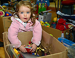 Emma Jane Cooper (2) from Bettystown has a good rummage around one of the many boxes of toys on sale at the Sale of Work in St. Mary's Parish Church Hall in Julianstown. Photo: Andy Spearman.