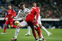 Nacho of Real Madrid and Iago Aspas of Sevilla during La Liga match between Real Madrid and Sevilla at Santiago Bernabeu Stadium in Madrid, Spain. February 04, 2015. (ALTERPHOTOS/Caro Marin) /NORTEphoto.com