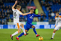 Sebastian Larsson of Hull City challenges Loic Damour of Cardiff City during the Sky Bet Championship match between Cardiff City and Hull City at the Cardiff City Stadium, Cardiff, Wales on 16 December 2017. Photo by Mark  Hawkins / PRiME Media Images.