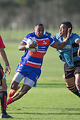 Lolohea Loco tries to fend off Waimano Mano. Counties Manukau Premier Club Rugby game between Ardmore Marist and Weymouth, played at Bruce Pulman Park on May 14th 2016. Ardmore Marist won the game 43 - 7 after leading 17 - 0 at halftime. Photo by Richard Spranger.