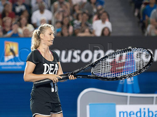11.01.2014. Sydney, Australia. Australian Open Tennis Championships. World Tour, Grand Slam, Australian Open Victoria Azarenka of Belarus returns the ball with a giant racquet during the Kids Day exhibition match ahead of the Australian Open tennis tournament in Melbourne, Australia, Jan. 11, 2014.