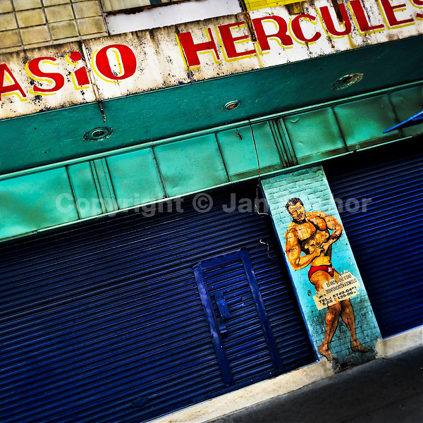 A painted artwork, depicting a bodybuilding athlete and serving as a public advertisement for a gym, is seen on the street in Buenavista, a neighborhood in Mexico City, Mexico, 29 October 2016.