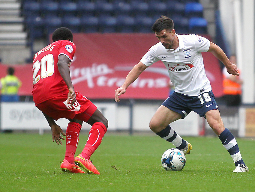Preston North End's David Buchanan vies for possession with Crawley Town's Bobson Bawling<br /> Photographer Rich Linley/CameraSport<br /> <br /> Football - The Football League Sky Bet League One - Preston North End v Crawley Town - Saturday 20th September 2014 - Deepdale - Preston<br /> <br /> &copy; CameraSport - 43 Linden Ave. Countesthorpe. Leicester. England. LE8 5PG - Tel: +44 (0) 116 277 4147 - admin@camerasport.com - www.camerasport.com
