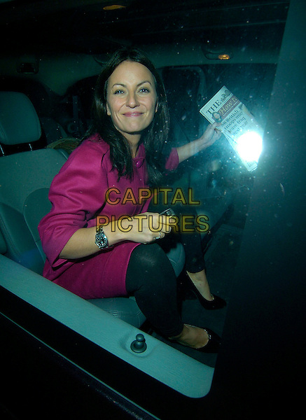 DAVINA McCALL.Leaving The Pride of Britain Awards held at ITV Studios, South Bank, London, England..October 9th 2007.full length car sitting pink magenta coat dress buttons black leggings shoes newspaper.CAP/CAN.©Can Nguyen/Capital Pictures