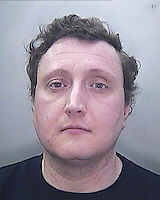 Pictured: Police handout picture of Kris Wade<br /> Re: A man from Cardiff is sentenced to 21 years in prison for murdering a neighbour at her flat in  Cardiff Bay.<br /> Kris Wade, 37, has admitted killing Christine James, 65, who was found dead just days after she failed to catch a flight to Florida in March.<br /> Mrs James was the mother-in-law of former Wales rugby captain Jonathan Humphreys.<br /> Her body was found when police searched her flat at Century Wharf. Wade was arrested on 7 March.<br /> Wade lived in nearby Hansen Court and has appeared via video link at Cardiff Crown Court from Long Lartin prison.