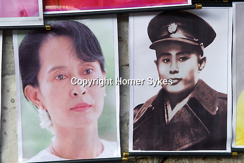 Aung San Suu Kyi and her father Aung San, posters hanging up in street vendors stall. Rangoon Tangon Burma Myanmar 2011. Aung San, is considered the father of modern day Burma.  He founded the modern day Burmese army and  negotiated Burmese independance from the British Empire and was assassinated by rivals in 1947.