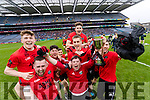 Glenbeigh Glencar captain Colin McGillicuddy and team mascot Cathal Griffin lifts the cup after his teams victory over Rock Saint Patricks in the Junior Football All Ireland Final in Croke Park on Sunday.