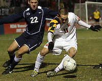 Casey Townsend #11 of the University of Maryland turns the ball away from Matt Smallwood #22 of Penn State during an NCAA 3rd. round match at Ludwig Field, University of Maryland, College Park, Maryland on November 28 2010.Maryland won 1-0.