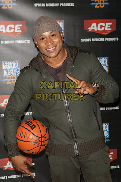 LL Cool J (James Todd Smith)<br /> Teams up with ACE Brand to launch the ACE Brand &quot;A&quot; Game Challenge, New York City, NY., USA.<br /> October 7th, 2013 <br /> half length green jacket beanie hat basketball hand finger pointing <br /> CAP/MPI/COR<br /> &copy;Corredor99/ MediaPunch/Capital Pictures