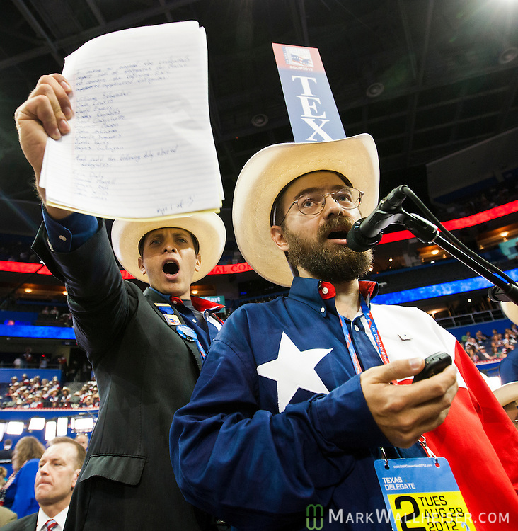 Jeremy Blosser (R) and Luis H. Larotta, Texas delegates, shout in protest over changes in Republican party rules that restricts the impact of grassroot movements at the 2012 Republican National Convention at the Tampa Bay Times Forum in Tampa on August 28, 2012.  The convention voted to adopt the new rules.