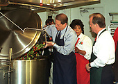 United States Vice President Al Gore pours vegetables into a large pot for soup at Martha's Table, a shelter that provides meals to the homeless in Washington, D.C. on 15 October, 1999.  Olivia Ivy, Director of Operations at Martha's Table, and US Representative Tony Hall (Democrat of Ohio), former Chair of the US House Select Committee on Hunger, look on.<br /> Credit: Ron Sachs / CNP