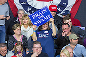 A supporter holds a campaign sign during a Make American Great Rally at Atlantic Aviation in Moon Township, Pennsylvania on March 10th, 2018. Credit: Alex Edelman / CNP