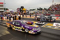 May 13, 2011; Commerce, GA, USA: NHRA pro stock driver Vincent Nobile (near) races Erica Enders during qualifying for the Southern Nationals at Atlanta Dragway. Mandatory Credit: Mark J. Rebilas-
