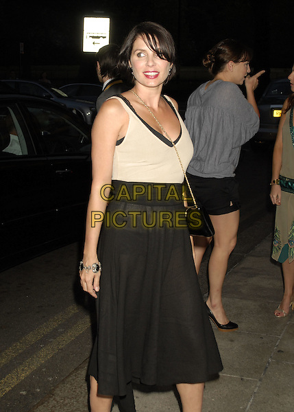SADIE FROST.Arrivals - Dorchester Bar Launch Party, .The Dorchester, London, England, .June 27th 2006..half 3/4 length black skirt sheer see through thru.Ref: SW.www.capitalpictures.com.sales@capitalpictures.com.©Stephen Walters/Capital Pictures.