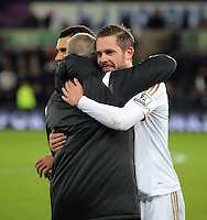 Swansea manager Alan Curtis celebrates his team's win with Gylfi Sigurdsson after the Barclays Premier League match between Swansea City and Watford at the Liberty Stadium, Swansea on January 18 2016