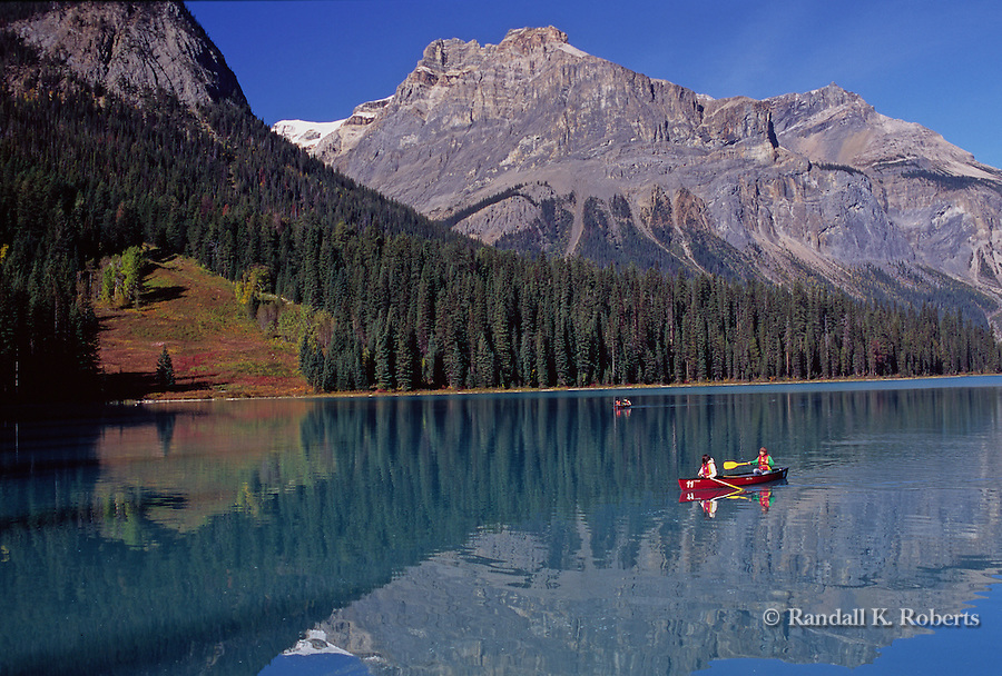 Canoers enjoy Emerald Lake in Yoho National Park, British Columbia, Canada
