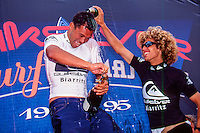Sunny Garcia (HAW) with Rob Machado (USA) after winning the 1995 Quiksilver Pro France at the Grand Plage, Biarritz in the South West of France. Photo: joliphotos.com