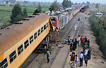 Egyptians gather at the scene of a train collision near Kom Hamadah, in the Beheira province in the Nile delta, Egypt on February 28, 2018. The death toll of the train crash that took place in Beheira province northern the capital Cairo on Wednesday has risen to 15, official MENA news agency reported. Beheira security chief Alaa El-Din Abdel-Fattah explained earlier on Wednesday that the accident took place as two cabins derailed from a passenger train and hit a cargo train in Kom Hamada district of Beheira. Photo by Amr Sayed