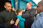 Cardinal Timothy Dolan, the archbishop of New York, blesses a woman during a visit to a camp for internally displaced families in Ankawa, near Erbil, Iraq, on April 9, 2016. Dolan, chair of the Catholic Near East Welfare Association, is in Iraqi Kurdistan with other church leaders to visit with Christians and others displaced by ISIS.