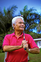 Senior Hawaiian man plays golf at the Pali Golf Course, Windward Oahu