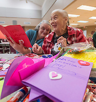 NWA Democrat-Gazette/BEN GOFF @NWABENGOFF<br /> Bertha Akins (left) of Rogers and Jolene Farris of Rogers have a laugh while making Valentine's Day cards Thursday, Feb. 7, 2019, at the Benton County Senior Activity and Wellness Center in Bentonville. Meals on Wheels of Benton County operates out of the center, delivering hot meals to 127 home-bound seniors in Benton County five days a week. The group was making the cards to be delivered with meals on Valentines Day.