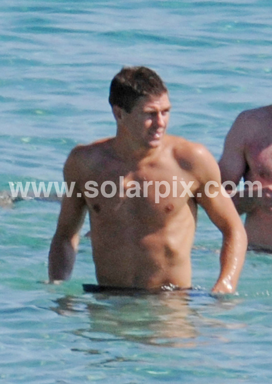 "**ALL ROUND PICTURES FROM SOLARPIX.COM**.**WORLDWIDE SYNDICATION RIGHTS EXCLUDING SPAIN - NO PUBLICATION IN SPAIN**.Liverpool Captain Steven Gerrard & wife Alex Curran on a beach holiday with friends in Ibiza..Gossips have said the England star had moved out of the family home and was living in a hotel in Southport - and his rumoured plans to move to Real Madrid were fuelled by their apparent marriage troubles..A holiday maker said that. ""They spent nearly th whole time apart during the beach day. She was chatting the whole time with her girl friends whilst he seemed to paint a  bit of  a lonely figure drinking beer and posing for the odd picture with some girl fans..They didn't look a happy loving couple""  fueling further rumors of the pressure their marriage is under at the moment...This pic: Steven Gerrard ..JOB REF: 11645         RAM       DATE: 10.07.2010.**MUST CREDIT SOLARPIX.COM OR DOUBLE FEE WILL BE CHARGED**.**MUST NOTIFY SOLARPIX OF ONLINE USAGE**.**CALL US ON: +34 952 811 768 or LOW RATE FROM UK 0844 617 7637**"