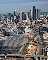Aerial of Safeco Field and Seattle skyline, showing construction of I-90 off-ramp to Edgar Martinez Drive and the Royal Brougham Way bridge, east of Safeco Field. The structures are part of the SR 519 Intermodal Access project.