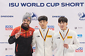 2nd February 2019, Dresden, Saxony, Germany; World Short Track Speed Skating; finals, 1500 meters for men in the EnergieVerbund Arena: Winner Kim Gun Woo from South Korea (M) at the awards ceremony alongside team mates and third-placed Lim Hyo Jun (r) and Charles Hamelin (l) from Canada.
