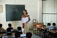 Varsha Karma, aged 28, teaches her class in the Vasudha Vidya Vihar school in Khargone, Madhya Pradesh, India on 12 November 2014. Varsha teaches a variety of subjects to her 5 year-old students. Fairtrade farmers get a 5% discount on school fees because the school was built using the Fairtrade Premium. Photo by Suzanne Lee for Fairtrade