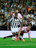 """Calcio, partita amichevole Cesena vs Juventus. Cesena, stadio """"Dino Manuzzi"""", 30 luglio 2014.<br /> Juventus midfielder Kingsley Coman, of France, is challenged by Cesena defender Daniele Capelli, right, during the friendly football match between Cesena and Juventus at Cesena's """"Dino Manuzzi"""" stadium, 30 July 2014.<br /> UPDATE IMAGES PRESS/Isabella Bonotto"""
