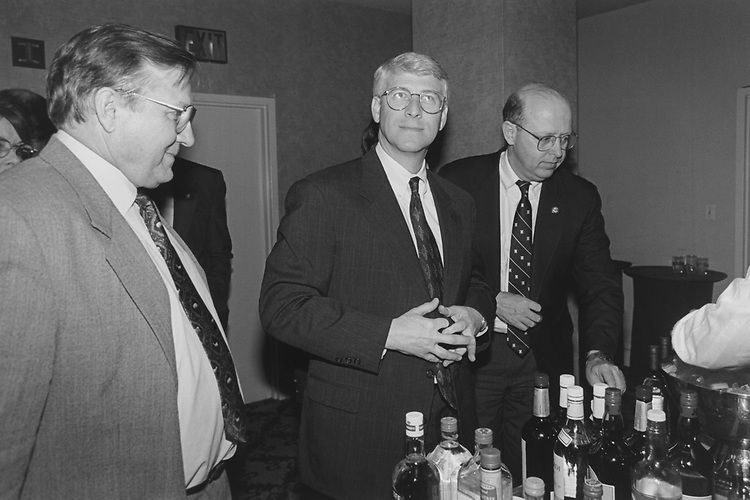 Rep. Nick Smith, R-Mich., Rep. Roger Wicker, R-Miss., and Rep. James B. Longley, R-Maine, go to the bar on Jan. 26, 1996. (Photo by Maureen Keating/CQ Roll Call via Getty Images)