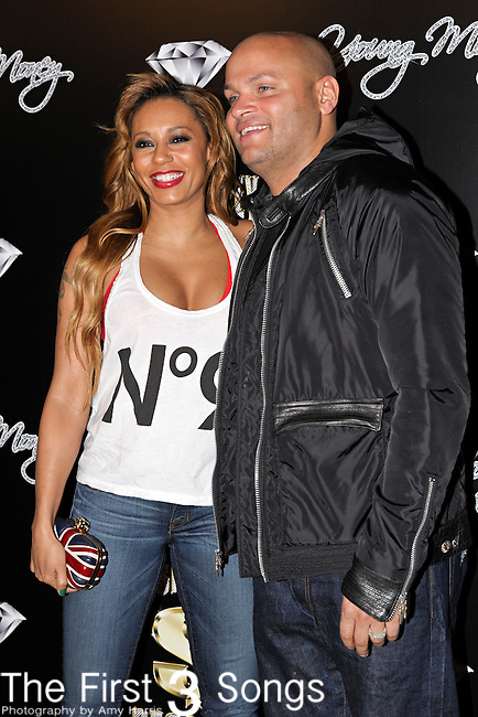 Former Spice Girl MELANIE BROWN and husband STEPHEN BELAFONTE attend the Cash Money Records Annual Pre-Grammy Awards Party at the Lot in West Hollywood on Saturday, February 12, 2011.