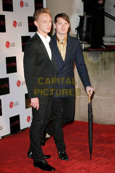 "PAUL STEWART & DAN GILLESPIE SELLS (THE FEELING) .""Scarlet"" - TV series launch, No. 1 Marylebone, Marylebone Road, London, England..April 30th, 2008.full length black suit blue pinstripe jacket trousers umbrella white shirt .CAP/AH.©Adam Houghton/Capital Pictures."